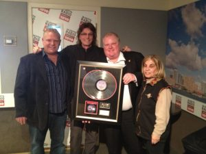 Gil Moore Presenting Mayor Rob Ford with Double Platinum Rock 'n Roll Machine album plaque